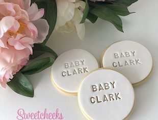 Personalised Baby Shower Cookies with names stamped into the icing.