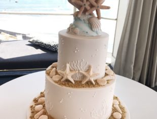 Beach themed Same sex gay wedding cake