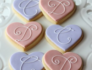 Fancy letter initial hand piped cookies same sex gay wedding favours